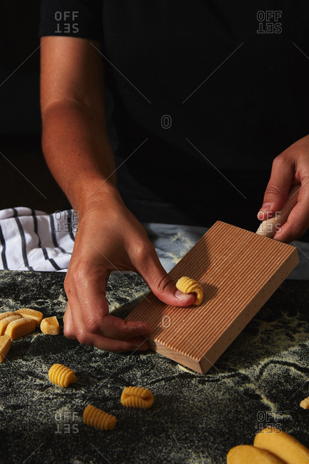 Person shaping dough for homemade pasta