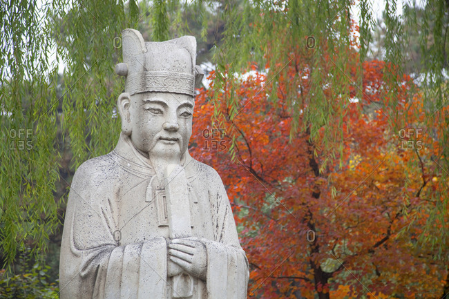 Stone statue of Tao priest at Ming Tombs in autumn, Beijing, China