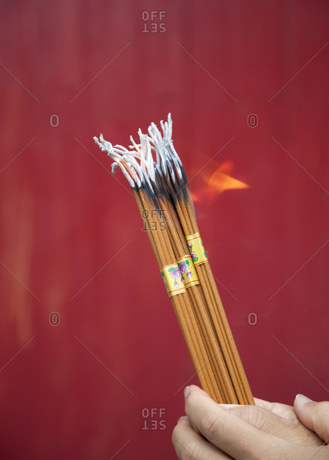 Shanghai, China - September 17, 2009: Close up of prayers sticks burning at the Jade Buddha Temple