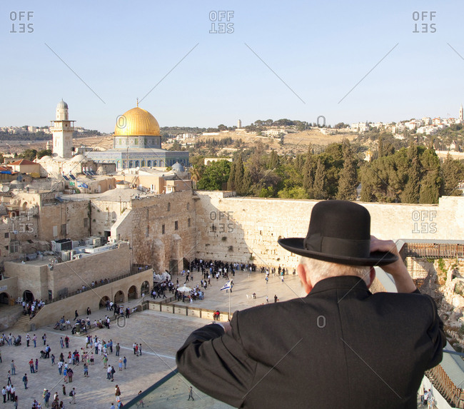 Jerusalem, Israel - June 14, 2011: The wailing wall and dome of the rock, old jewish man looking out onto square