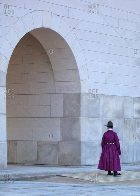 Guard at gate portal of Gyeongbokgung palace, Seoul, South Korea