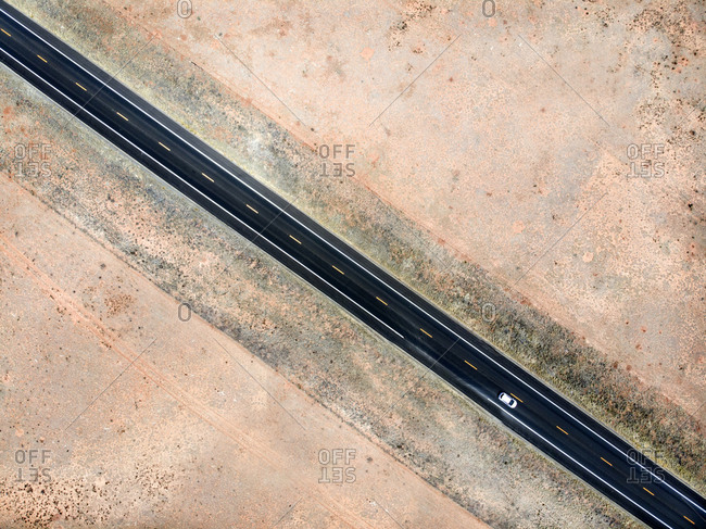 Drone view of lonely highway with one car in desert setting, Arizona, USA