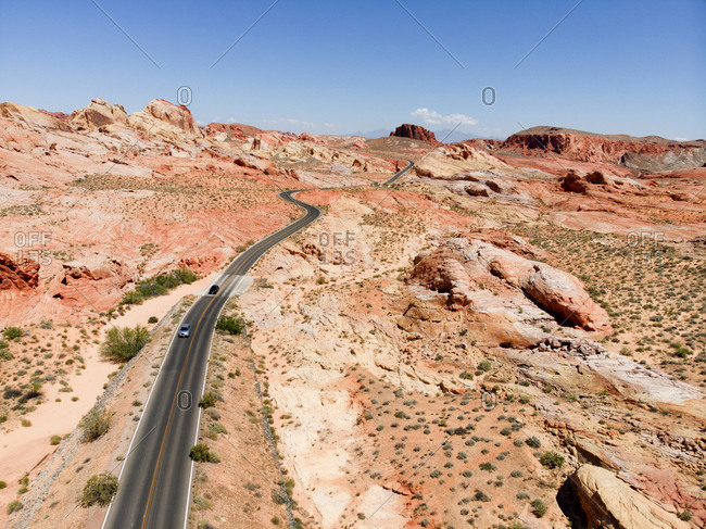 Cars driving on road in Valley of Fire State Park, Nevada, USA