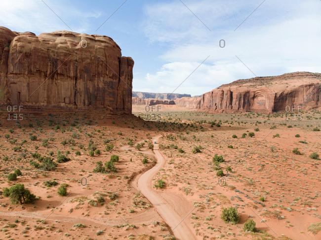 Dirt road in Monument Valley Navajo Tribal Park, Utah, USA
