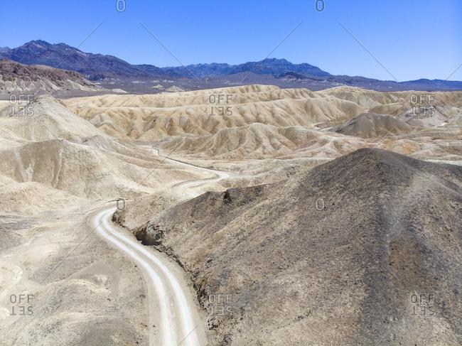 Dirt road through desert in Death Valley, California, USA