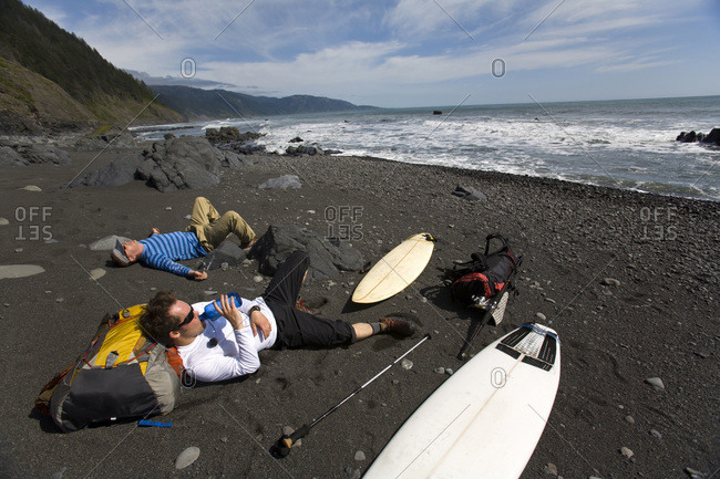 Two men backpack and surf on The Lost Coast, California.