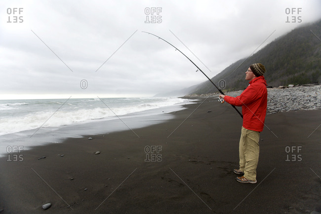 A man fishes in the Pacific Ocean off of The Lost Coast, California.