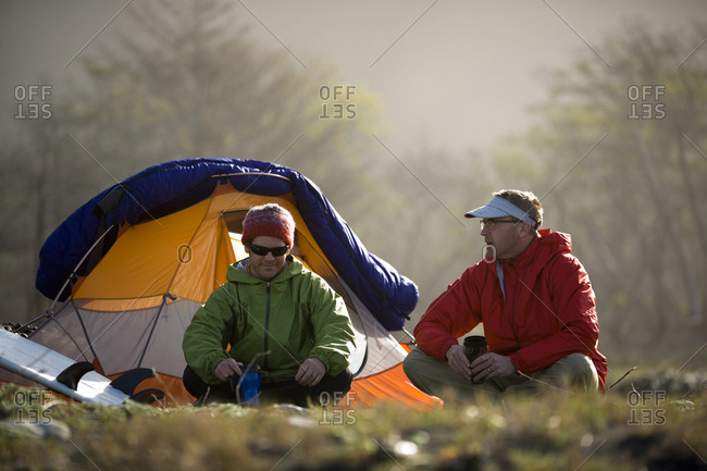 Two men sit outside their tent on The Lost Coast, California.