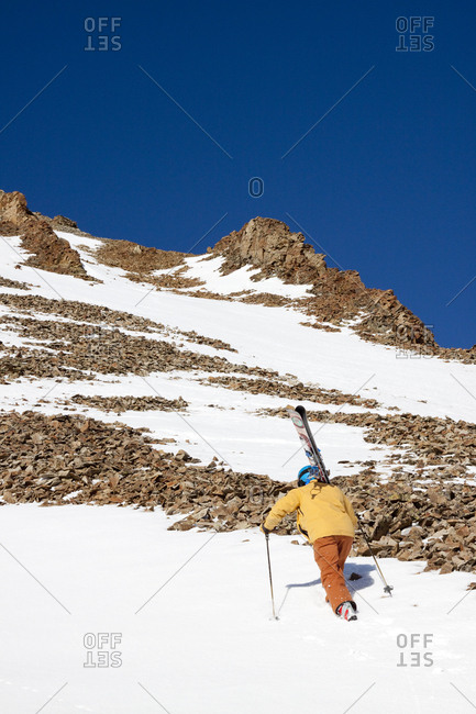 A male skier hikes to his ski line at Big Sky Resort in Big Sky, Montana.