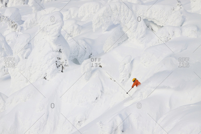 Male Skier Skiing On Snowy Landscape In Whitefish, Montana, Usa