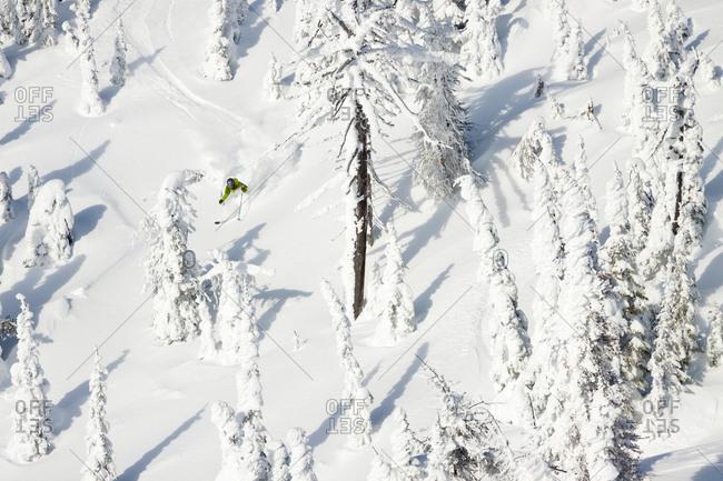A Lone Male Skier Makes A Deep Powder Turn At Whitefish Mountain Resort In Whitefish, Montana, Usa