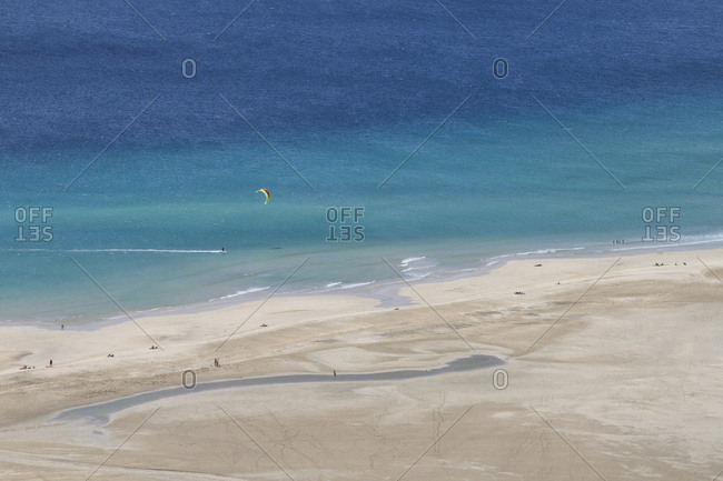 Aerial photo of a kite surfer in Fuerteventura's famous Sotavento beach. In Sotavento beach every year the kite surf and windsurf world championship is held.