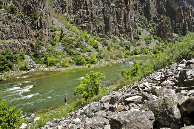 An angler fishes on the Gunnison River.