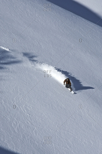 A man snowboards down a slope on Teton Pass, Wyoming.