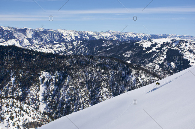 A man skiing an untouched slope in the Snake River Range near Hoback, Wyoming.