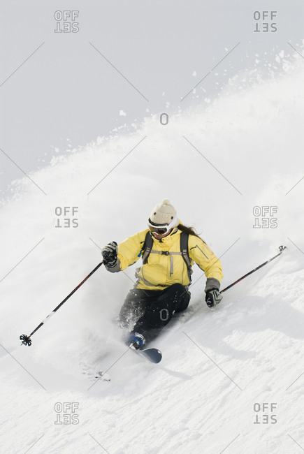 A woman skis the powder in the Canadian Rockies.