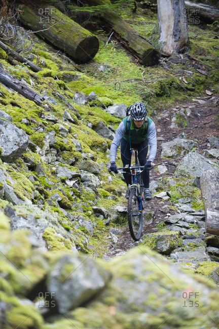 A mountain biker rides a rocky, single track  trail in northern Idaho.