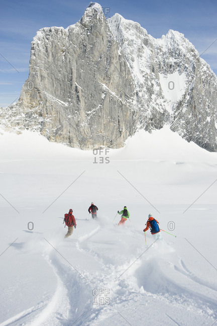 A group of backcountry skiers cross tracks in the Selkirk Mountains, Canada.