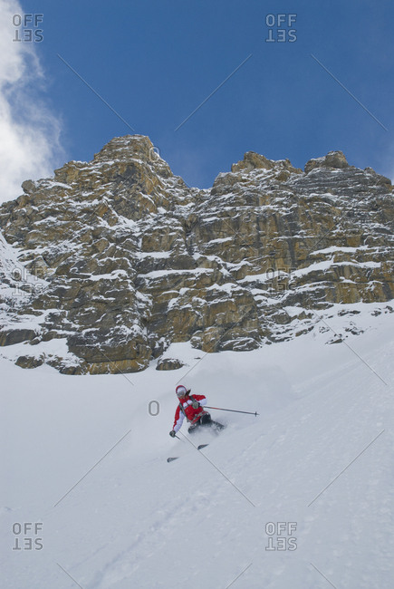 A woman skis a couloir in the Canadian Rockies.