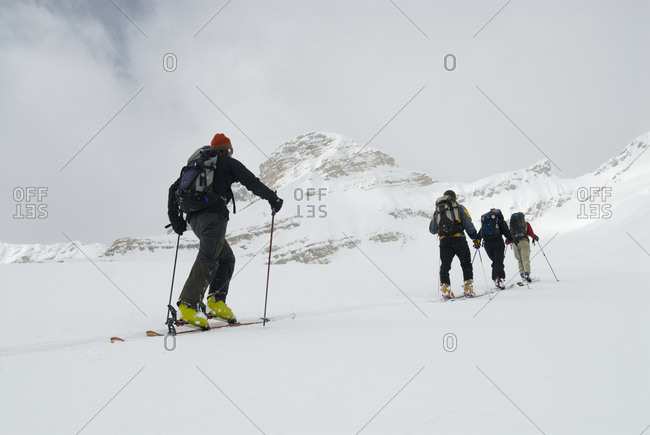 Skiers tour in the backcountry of the Canadian Rockies.
