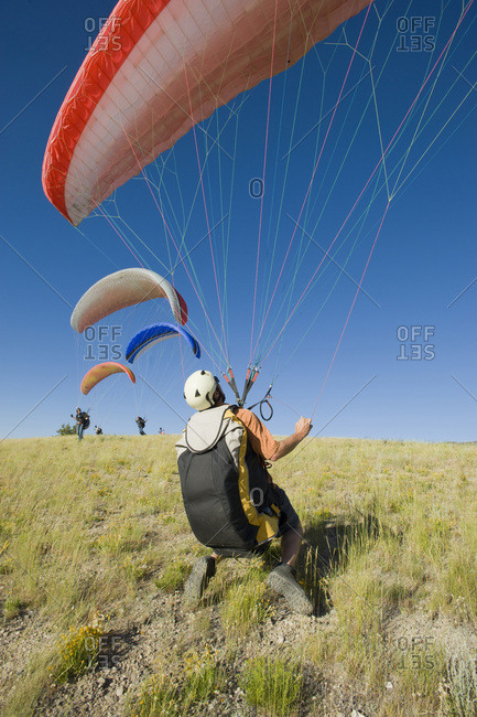 A paraglider finds the wind for a flight.