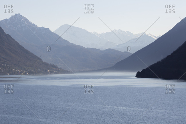 View down lake to snow capped mountain ranges
