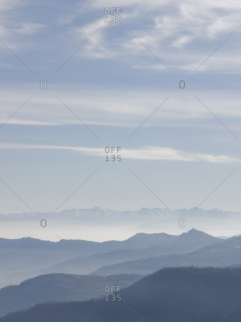 Elevated view across mountain ranges and clouds, winter
