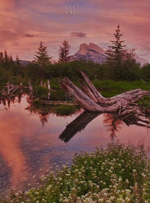 Twilight reflection of mountains in lake