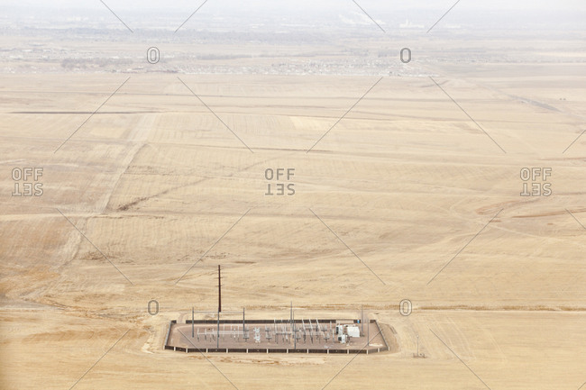 Aerial view of a remote high voltage electrical power distribution substation in the plains outside Denver, Colorado.