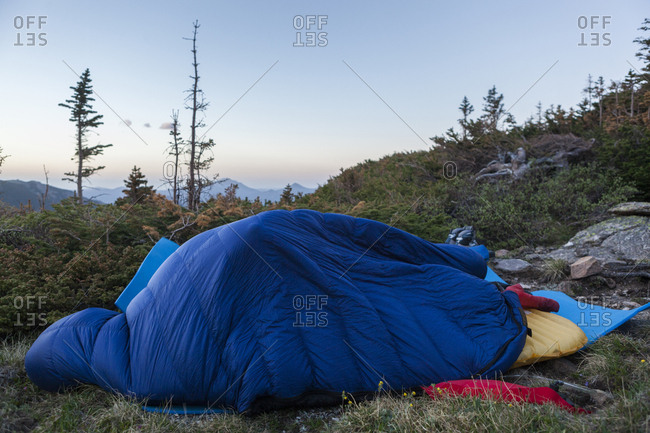 Climbers in their sleeping bag at Spectacle Lakes, Rocky Mountain National Park, Colorado.