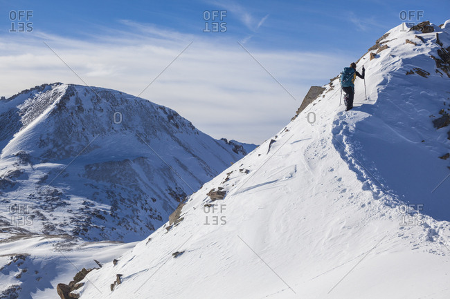 A hiker ascends the east ridge of Trico Peak, San Juan National Forest, Colorado.