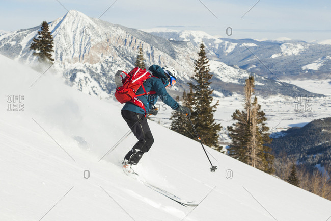 Woman skiing down Mount Emmons, Gunnison National Forest, Colorado, USA