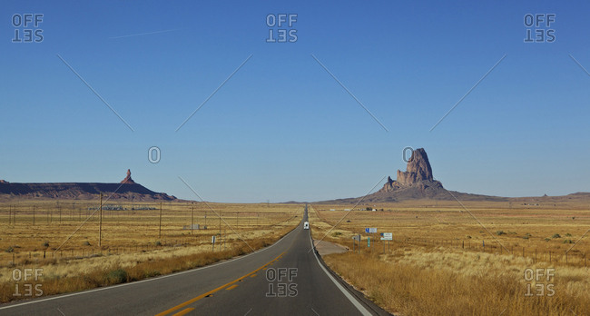 Empty road through desert at Monument Valley, Arizona, United States