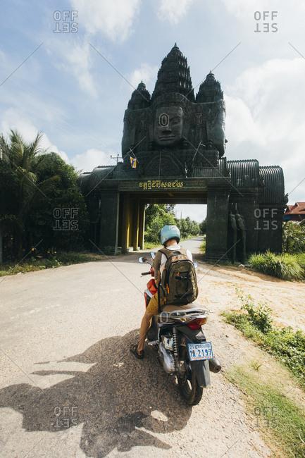 Cambodia, Siem Reap Province, Nokor Krau - November 20, 2017: Man on motorcycle, Nokor Krau, Siem Reap, Cambodia