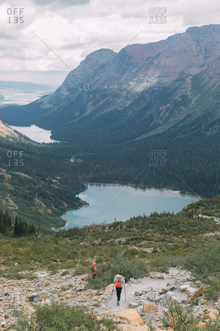 Hikers near lake, Glacier National Park, Montana, USA