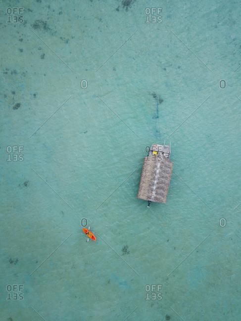 Orange kayak in the beautiful turquoise lagoon in Cook Islands