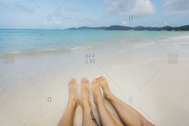 A couple enjoying the incredible beach by themselves in Australia