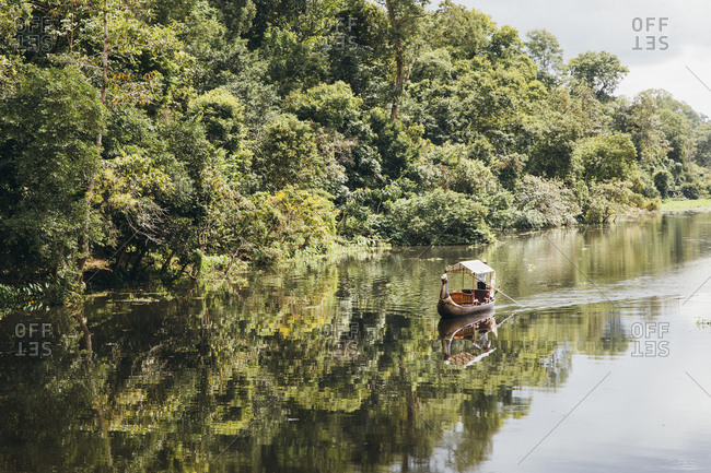 Ancient Cambodian boat on the river, Siem Reap