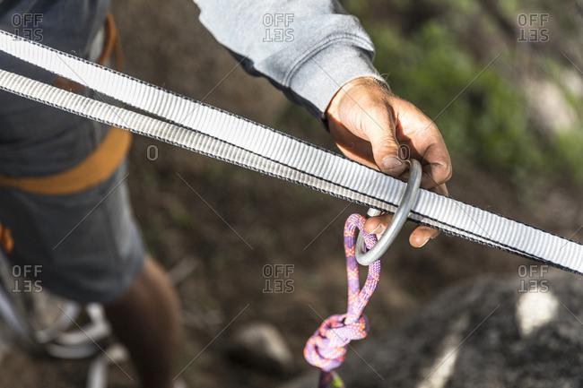 Slackliner is preparing insurance for walking on the rope
