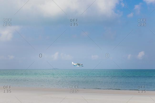 Seaplane flying above the ocean in Australia