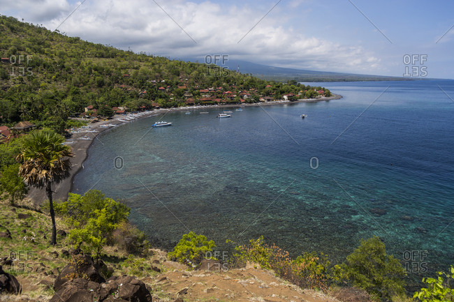 A bay and some boats in Amed, Bali, Indonesia from a lookout point.