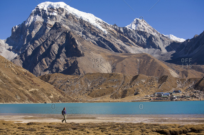A woman hiking near Gokyo Lake, Khumbu region, Nepal.
