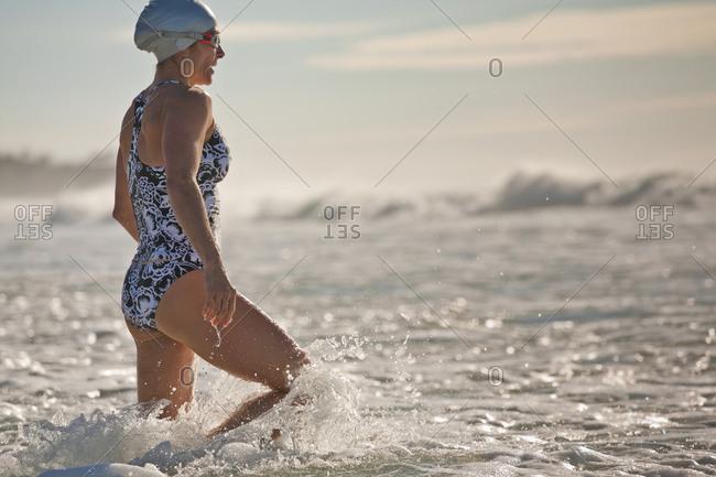 A woman prepares for a surf swim at Sunshine Beach, Queensland, Australia.