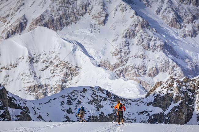 Two mountain climbers traversing glacier, Denali National Park, Alaska, USA