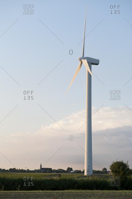 A wind turbine amidst the Dutch Countryside