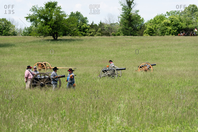 Virginia, USA - May 18, 2019: Men shooting cannons during Civil War Reenactment