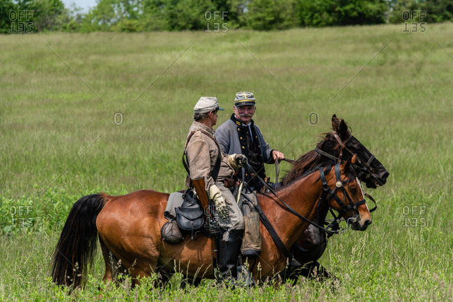 Virginia, USA - May 18, 2019: Men on horses during Civil War Reenactment