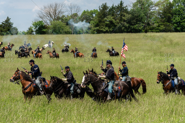 Virginia, USA - May 18, 2019: Men on horses firing guns during Civil War Reenactment