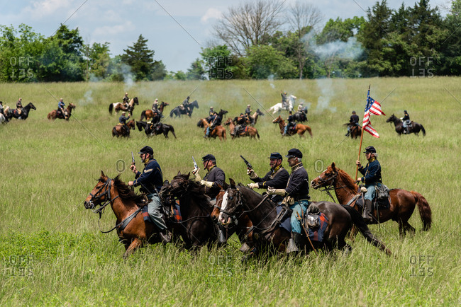 Virginia, USA - May 18, 2019: Soldiers on horses firing guns during Civil War Reenactment