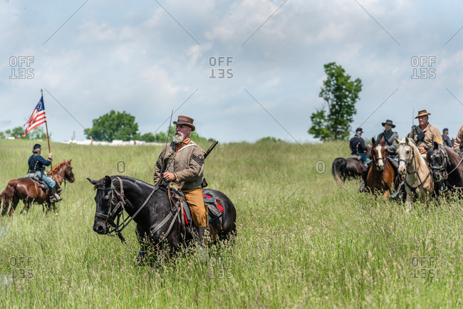 Virginia, USA - May 18, 2019: Soldiers on horses with swords during a Civil War Reenactment